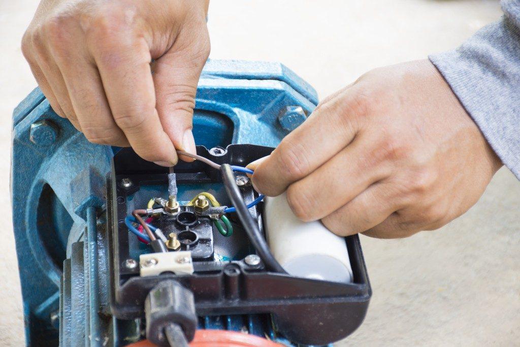 man fixing submersible pump