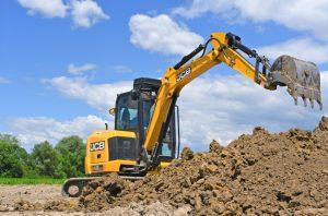 Excavator digging up