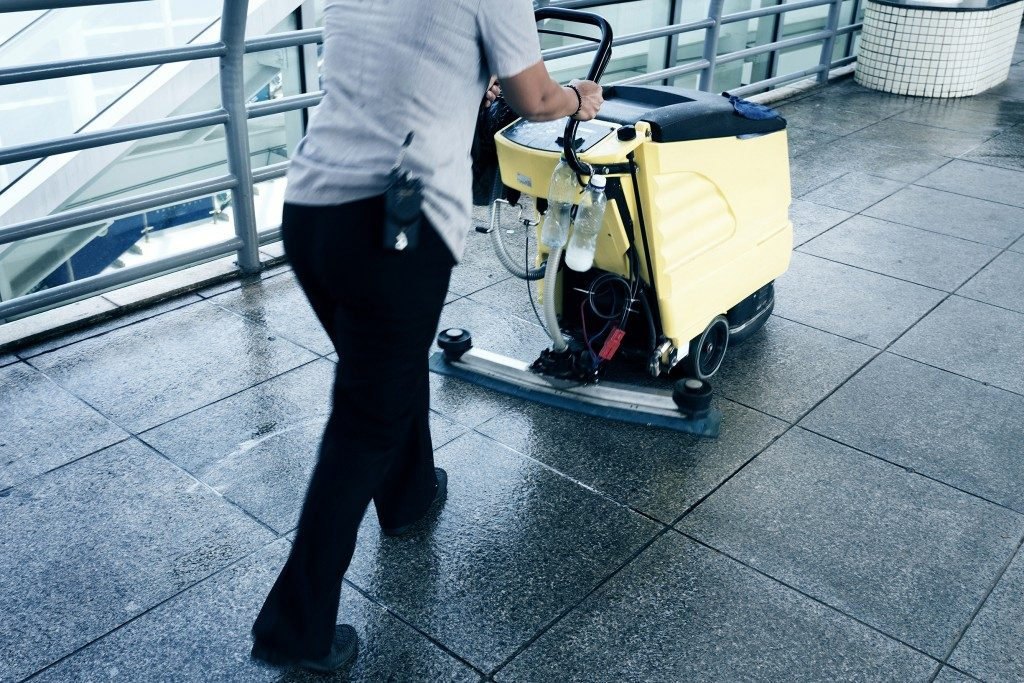 Man using floor cleaning machine