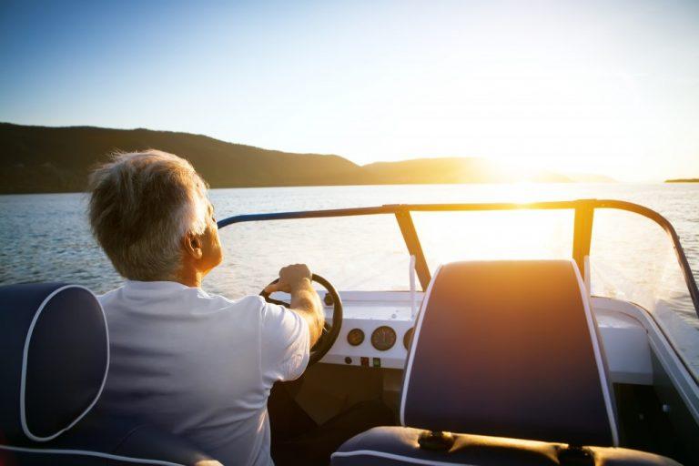 man driving a speedboat