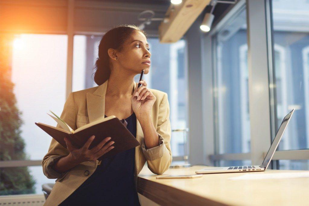 Female entrepreneur thinking