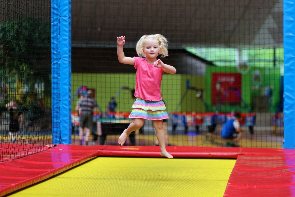 child playing at a trampoline park