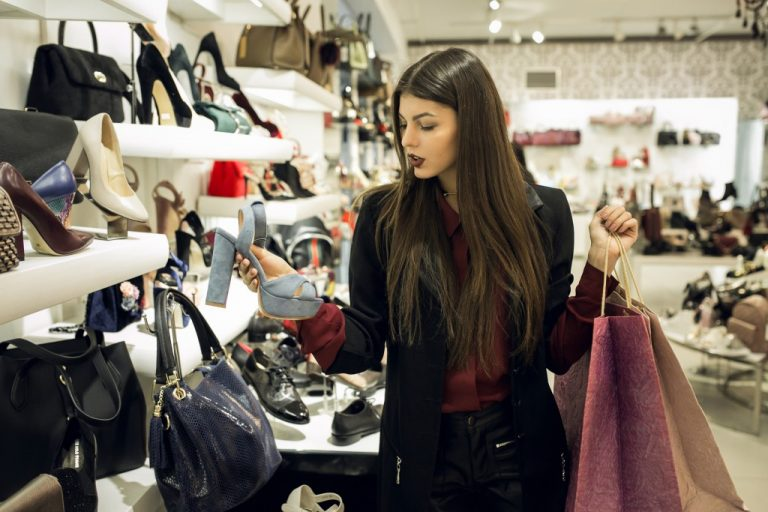 Girl shopping for shoes inside the store