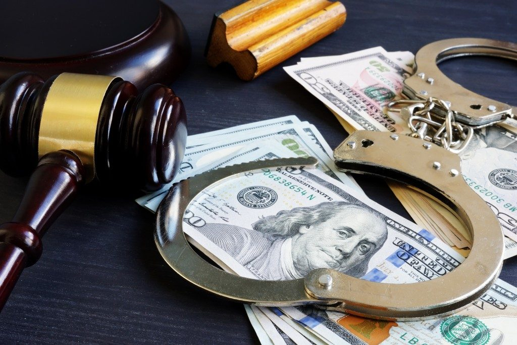 bail concept with gavel, money and handcuffs