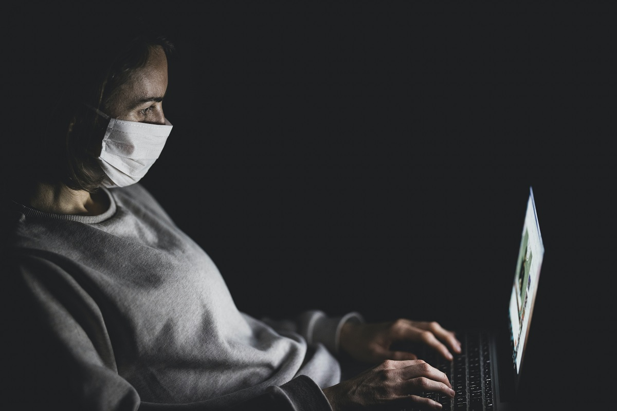 woman working while wearing face mask
