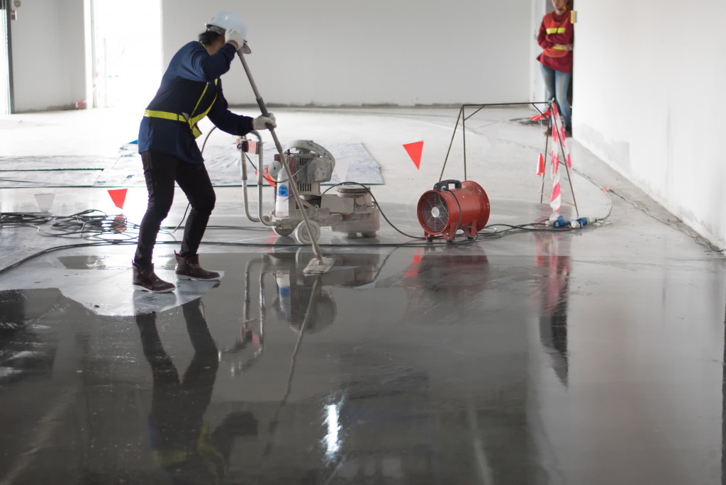 person cleaning an office floor
